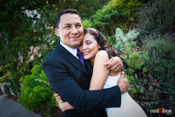Anghi gets a hug from his brother before she married Andy at The Canal in Seattle. (Photo by Dan DeLong/Red Box Pictures)