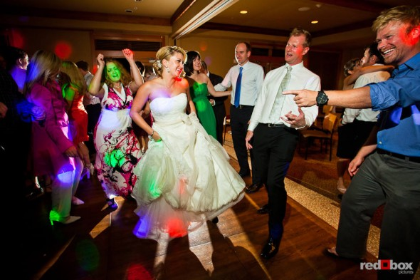 Angi and Mike dance with guests their wedding at The Willows Lodge in Woodinville, WA. (Photo by Dan DeLong/Red Box Pictures)
