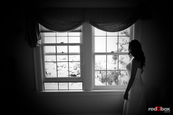 Anghi, the bride, waits for her groom, Andy, to arrive before their wedding at The Canal in Seattle. (Photo by Dan DeLong/Red Box Pictures)