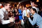 Guests of Anghi and Andy's wedding singalong during the couple's reception at The Canal in Seattle's Ballard neighborhood. (Photo by Dan DeLong/Red Box Pictures)