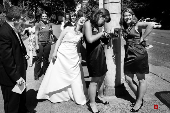 Katherine has a laugh with her wedding party while walking back to after a photography session at Freeway Park in Seattle. (Photo by Dan DeLong/Red Box Pictures)