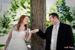Bride Katherine and her groom Bryan have fun during a portrait session in Freeway Park, Seattle. (Photo by Dan DeLong/Red Box Pictures)