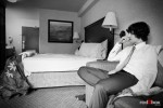 Andy, the groom, is deep in thought in his Seattle hotel room before his wedding to Anghi at The Canal. (Photo by Dan DeLong/Red Box Pictures)