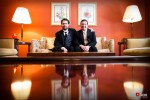 Groom Bryan and his best man are photographed in one of classic Women's University Club in Seattle. (Photo by Dan DeLong/Red Box Pictures)