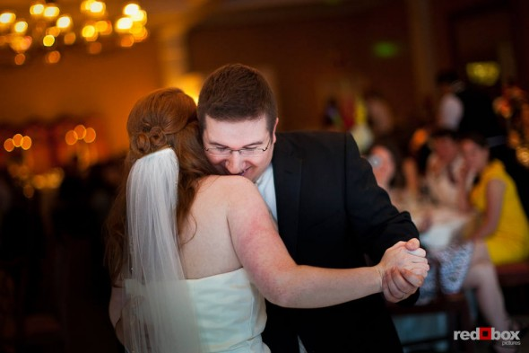 Newlyweds Katherine and Bryan share their first dance at the Women's University Club in Seattle. (Photo by Dan DeLong/Red Box Pictures)