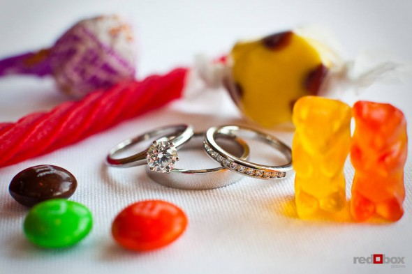 Katherine and Bryan's rings are framed by candy they provided for guests during their wedding at the Women's University Club in Seattle. (Photo by Dan DeLong/Red Box Pictures)