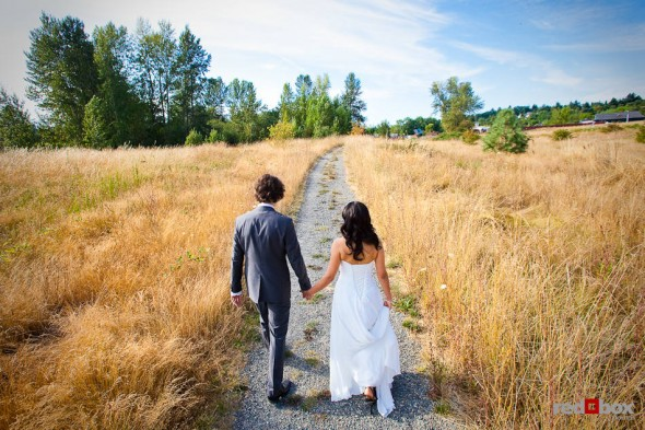 Anghi and Andy walk through the Center for Urban Horticulture in Seattle before their wedding. (Photo by Dan DeLong/Red Box Pictures)