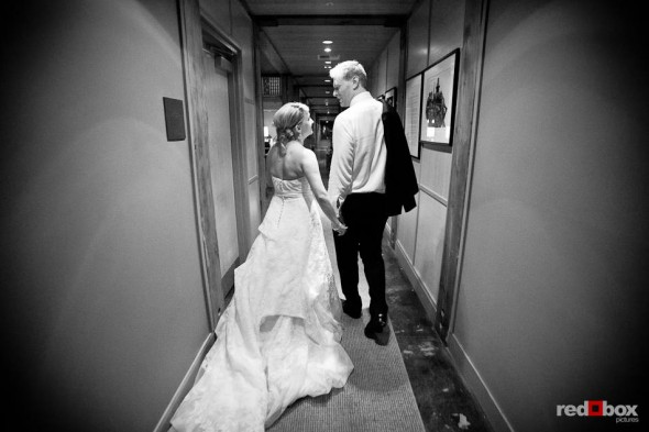 Newlyweds Angi and Mike walk through the hallway to their room at Willows Lodge in Woodinville, WA. (Photo by Dan DeLong/Red Box Pictures)