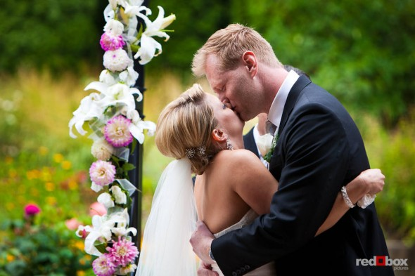 Angi and Mike seal their marriage with a kiss at Willows Lodge in Woodinville, WA. (Photo by Dan DeLong/Red Box Pictures)