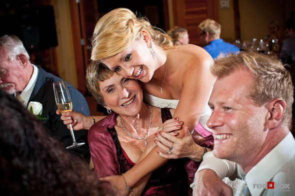 Angi hugs her new mother-in-law during her wedding reception at Willows Lodge in Woodinville, WA. (Photo by Dan DeLong/Red Box Pictures)