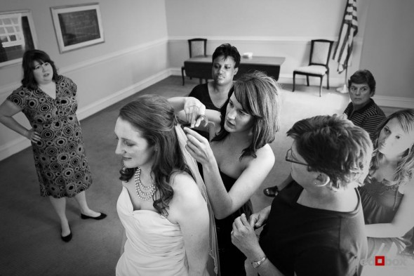 Katherine has help with her veil while getting ready to marry Bryan at the Women's University Club in Seattle. (Photo by Dan DeLong/Red Box Pictures)