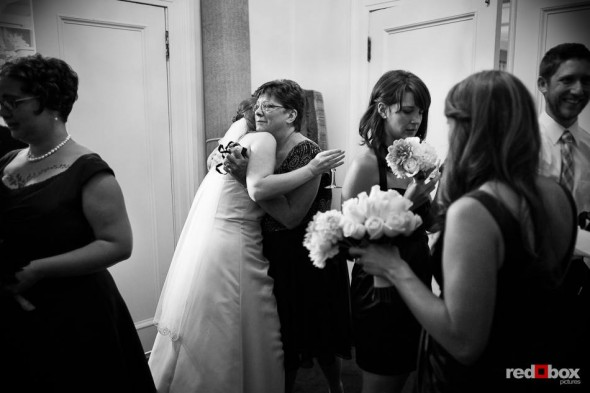 Katherine is congratulated by family after being married at Seattle's Women's University Club. (Photo by Dan DeLong/Red Box Pictures)