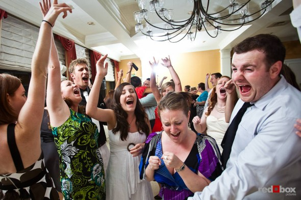 Guests sing along while dancing at the wedding reception of Katherine and Bryan at the Women's University Club in Seattle. (Photo by Dan DeLong/Red Box Pictures)