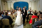 Katherine and Bryan walk down the aisle after being married at the Women's University Club in Seattle. (Photo by Dan DeLong/Red Box Pictures)