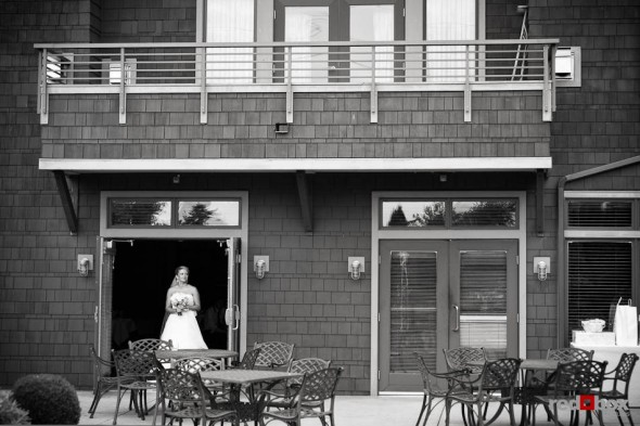 Angi stands in the doorway of before walking down the aisle to marry Mike during their wedding at Willows Lodge in Woodinville, WA on Sunday, August 29, 2010. (Photo by Dan DeLong/Red Box Pictures)