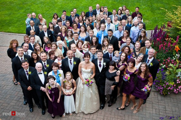 Suzy and Michael pose with their guests after being married at Kiana Lodge in Poulsbo, WA. (Photo by Andy Rogers/Red Box Pictures)