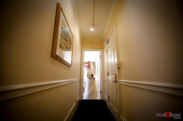 The bride gets ready to leave the Sorrento Hotel before she heads to her wedding at The Hall at Fauntleroy in West Seattle, Washington. (Seattle Wedding Photography Scott Eklund Red Box Pictures)
