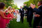 The bride and groom get high and low fives from their bridal party following their wedding at The Hall at Fauntleroy in Seattle, Washington. Seattle Wedding Photographer Red Box Pictures Scott Eklund