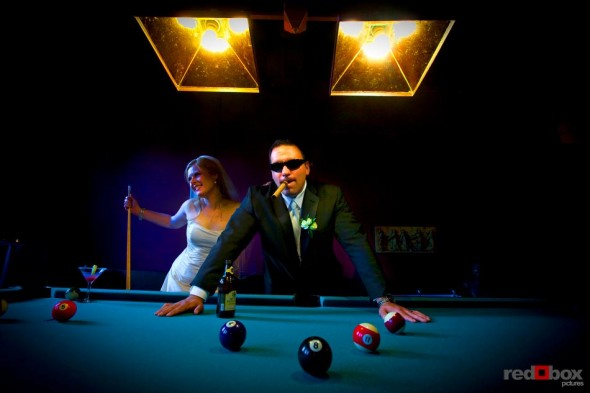 The bride & groom at the pool table at The Hall at Fauntleroy in West Seattle, Washington. (Wedding Photography By Scott Eklund Red Box Pictures Seattle)
