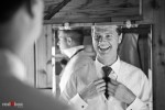Michael adjusts his tie before his wedding with Suzy at Kiana Lodge near Bainbridge Island, WA. (Photo by Andy Rogers/Red Box Pictures)