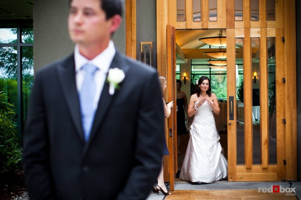 """Nadine approaches her future husband, Brian, for their """"first look', or reveal, outside The Plateau Club in Sammamish, WA. (Photo by Dan DeLong/Red Box Pictures)"""