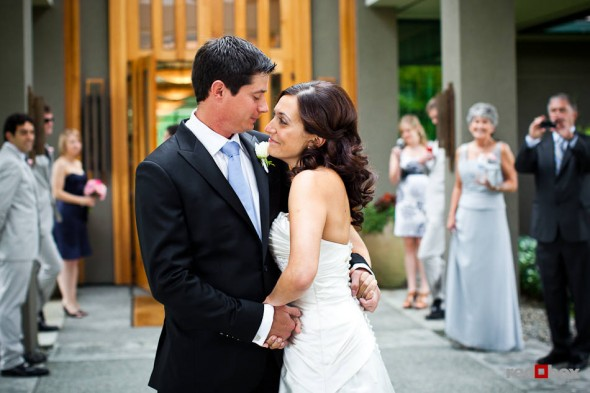 """Nadine and Brian hug after their """"first look', or reveal, at The Plateau Club in Sammamish, WA. (Photo by Dan DeLong/Red Box Pictures)"""