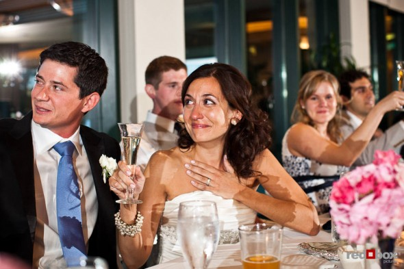 Nadine, with her new husband Brian, becomes emotional during toasts at their wedding reception at the Plateau Club in Sammamish, WA. (Photo by Dan DeLong/Red Box Pictures)