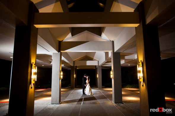 Outside the Plateau Club in Sammamish, WA, Brian and Nadine kiss under the venue's entryway. (Photo by Dan DeLong/Red Box Pictures)