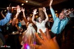 The bride and guests dance to the music at Suzy and Michael's wedding reception at Kiana Lodge in Poulsbo, WA. (Photo by Dan DeLong/Red Box Pictures)