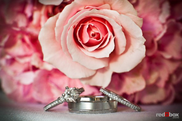 Nadine and Brian's wedding rings are photographed with flowers a the Plateau Club in Sammamish, WA, their reception venue. (Photo by Dan DeLong/Red Box Pictures)