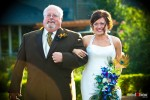 Liz becomes emotional while walking down the aisle with her father during her outdoor wedding ceremony at Hidden Meadows in Snohomish, WA. (Photo by Dan DeLong/Red Box Pictures)