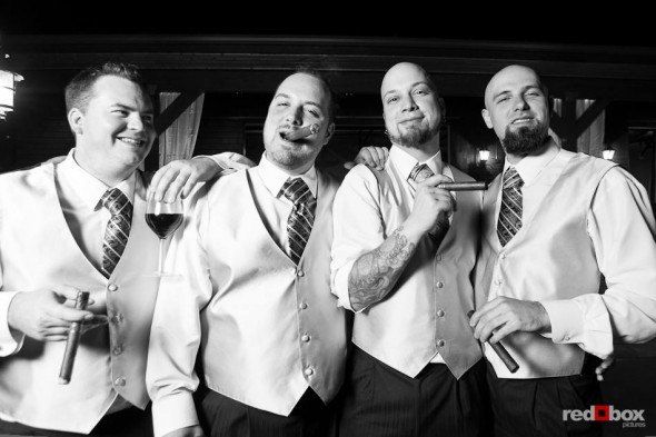 Ted and his groomsmen light up cigars during Ted and Liz's wedding reception at Hidden Meadows in Snohomish, WA. (Photo by Dan DeLong/Red Box Pictures)