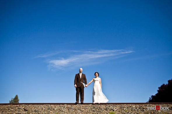 Liz and Ted are photographed against a brilliant blue sky before being married at Hidden Meadows in Snohomish, WA. (Photo by Dan DeLong/Red Box Pictures)