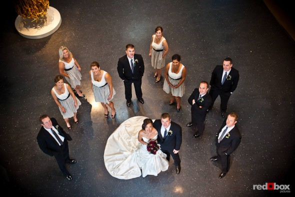 Nora and Neill pose with their wedding party inside the Bellevue Art Museum in Bellevue, WA. (Photo by Dan DeLong/Red Box Pictures)