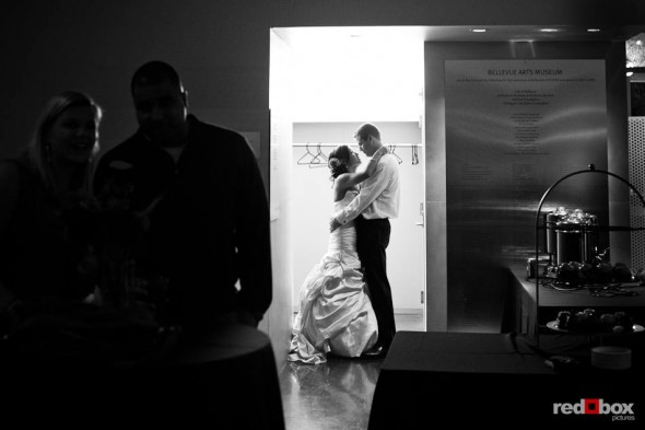 In the Bellevue Art Museum, Nora and Neill share a private moment during their wedding reception in Bellevue, WA. (Photo by Dan DeLong/Red Box Pictures)