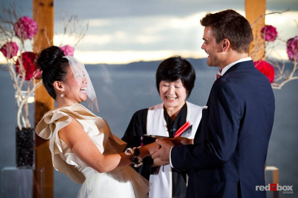 Angie and Jordan laugh during their wedding ceremony at the Edgewater Hotel in Seattle. (Photo by Dan DeLong/Red Box Pictures)