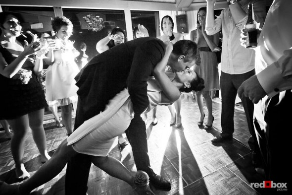 Jordan dips his bride, Angie, while they dance during their wedding reception at the Edgewater Hotel in Seattle. (Photo by Dan DeLong/Red Box Pictures)