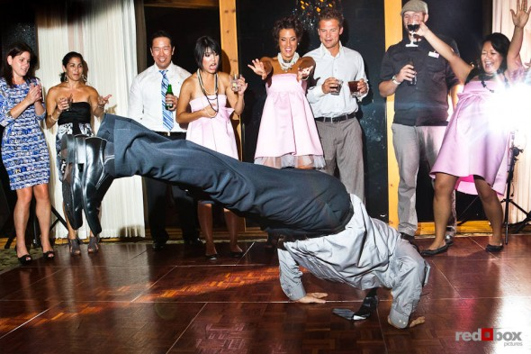 Angie and Jordan's guests dance during their wedding reception at the Edgewater Hotel in Seattle. (Photo by Dan DeLong/Red Box Pictures)