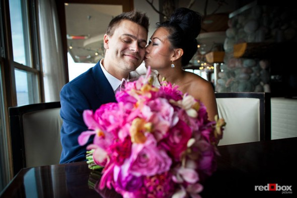 Angie plants a kiss Jordan after their first look on their wedding day at the Edgewater Hotel in Seattle. (Photo by Dan DeLong/Red Box Pictures)