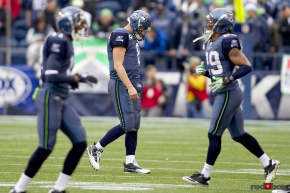 Seattle Seahawk's quarterback Matt Hasselbeck walks of the field, as defenders walk on, following an interception in Carolina territory late in the first half at Qwest Field. (Scott Eklund/Red Box Pictures/Seattle Sports Photography)