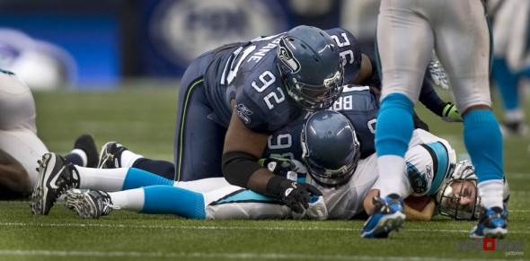 Raheem Brock (right) and Brandon Mebane in the fourth quarter as the Seattle Seahawks beat the Carolina Panthers 31-14. Sports Photography By Scott Eklund/Red Box Pictures/Seattle