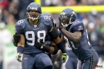 Raheem Brock (98) celebrates a fourth quarter sack with Chris Clemons as the Seattle Seahawks beat the Carolina Panthers 31-14 at Qwest Field in Seattle on Sunday December 5, 2010. (Seattle Sports Photography By Scott Eklund/Red Box Pictures)