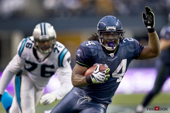 Seattle running back Marshawn Lynch breaks off a 22-yard run for a fourth quarter touchdown for the final score of the game as the Seattle Seahawks beat the Carolina Panthers 31-14 at Qwest Field. (Seattle Sports Photography By Scott Eklund/Red Box Pictures)