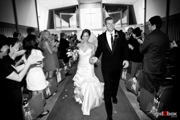 Nora and Neill walk down the aisle after being married at the First United Methodist Church in Bellevue, WA. (Photo by Dan DeLong/Red Box Pictures)