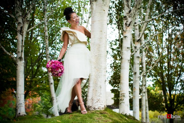 On her wedding day, bride Angie is photographed near Myrtle Edwards Park in Seattle. (Photo by Dan DeLong/Red Box Pictures)