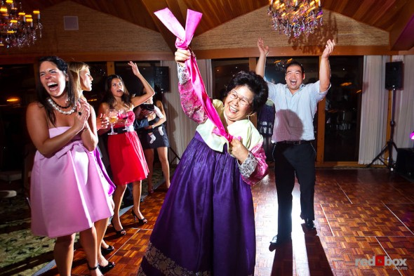 Guests, including the bride's mother, dance during Angie and Jordan's rocking wedding reception at the Edgewater Hotel in Seattle. (Photo by Dan DeLong/Red Box Pictures)