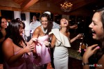 Angie and her girlfriends laugh on the dance floor during her wedding reception at the Edgewater Hotel in Seattle. (Photo by Dan DeLong/Red Box Pictures)