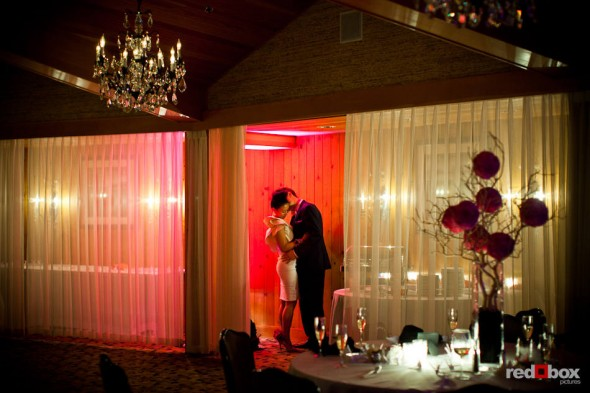 Angie and Jordan share a private moment during their wedding reception at the Edgewater Hotel in Seattle. (Photo by Dan DeLong/Red Box Pictures)