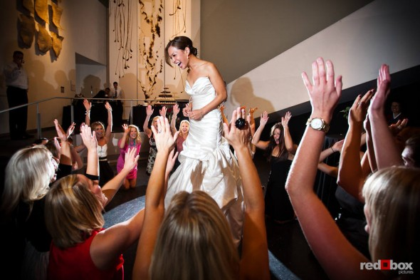 Nora, the bride, is serenaded by her sorority sisters during her wedding reception at the Bellevue Art Museum. (Photo by Dan DeLong/Red Box Pictures)