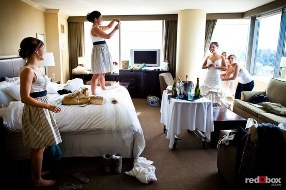 Her bridesmaids help Nora get ready for her wedding in a room at the Westin in Bellevue, WA. (Photo by Dan DeLong/Red Box Pictures)